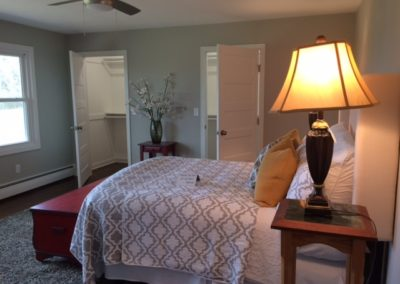 Master bedroom with dual walk-in closets